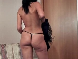Exotic anilos nelly removes her black corset and lounges in her chair