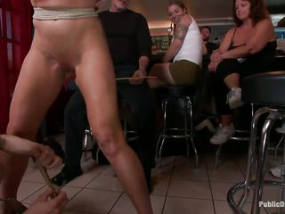 mature pornstar abased in a bar