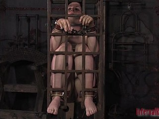 Gagged floozy in cage gets some painful orgasm