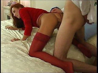Salacious honey in red stockings surrenders to stunning anal assault
