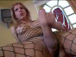 Blond shemale in fishnet has a large rod