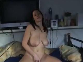 Breasty hottie rubs herself hard