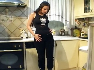 Busty sweetheart with leather boots masturbates in the kitchen
