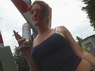 German slut and her partner go behind the bushes to fuck