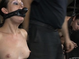 This poor woman getting her throat stuffed with the weird toy