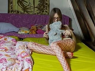 Pretty young hotty in glasses shows her pants