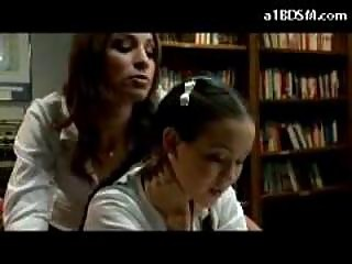 Schoolgirl In Petticoat Getting Spanked By Other Girl In The Library