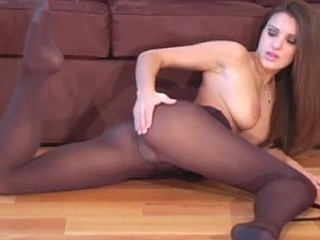 Brunete gorgeous slut in the hose is posing topless looks sexy