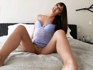 Cutie plays with dildo