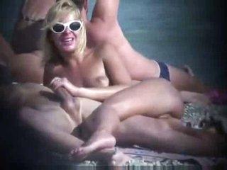Voyeur golden-haired grabbing his dick on nudist beach