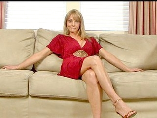 Sandy blond haired cougar masturbates with a long vibrator