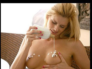 Darryl Hanah plays with sexy lotion on her sweet naturally large boobs