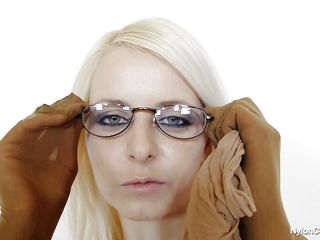 sexy golden-haired with dorky glasses masturbates covered in nylon
