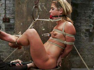 fastened up blonde taking her torture