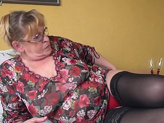 Hot mature whore on high heels is rubbing her nipples and cunt