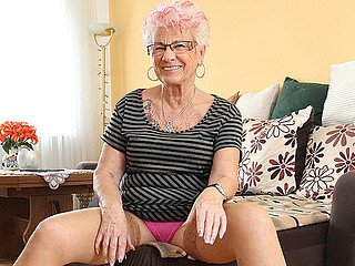 Look at this mature whore in pink lingerie looking seductive