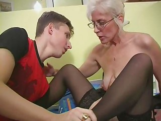 Mature with Silver Hair Glasses and Nylons Wakes the Chap