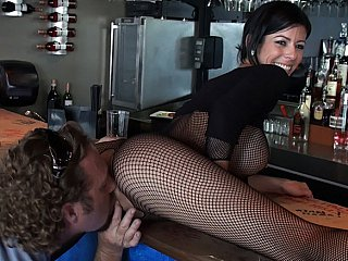 Barmaid with big round tits!
