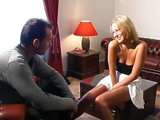 Hot golden-haired gal can't make a decision which cock to engulf and fuck so she does 'em both