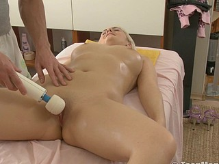 Blonde is massaged with a huge ball dildo