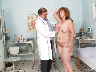 aged lady spreading her legs for her pussy examination