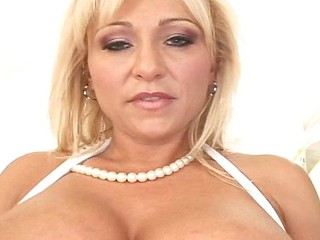 Sexy blonde MILF with biggest marangos and pierced nipples gets a delivery in the anal opening