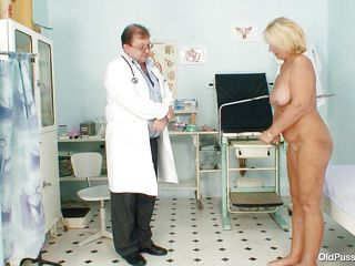 blonde older getting ready to examine her body