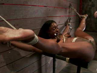 bound ebony slut and a darksome vibrator