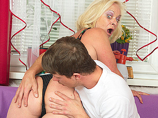Bawdy and ugly blonde whore is riding a corpulent donger and blowing deep