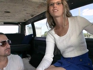 Nerdish babe appears in the car between two lascivious men