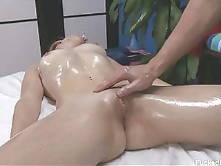 Nice-looking Blonde Chick Receives Covered in Body Oil and Her Clitoris Massaged